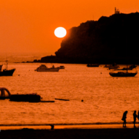 Sunset and yong people in San Marinho Do Porto - Portugal